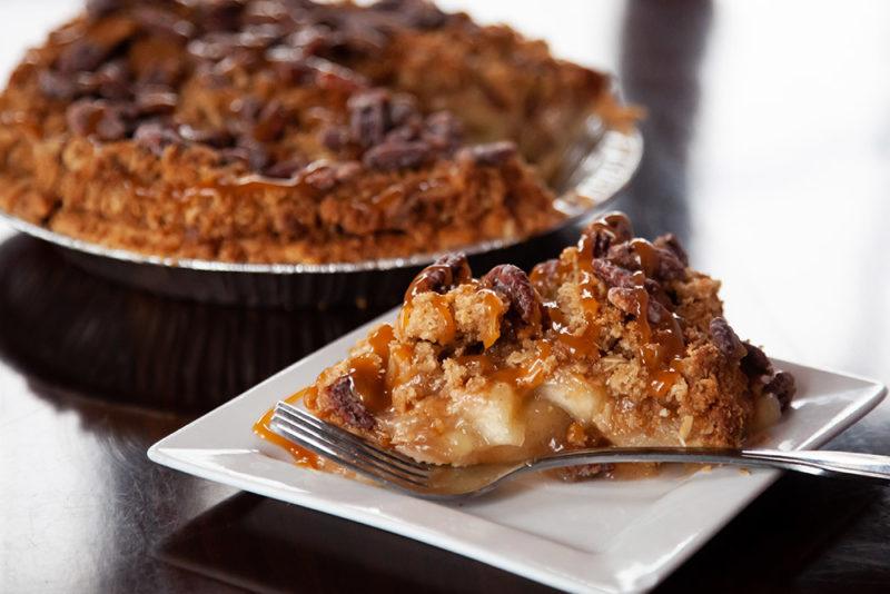A slice of Caramel Apple Pecan Crumb Pie