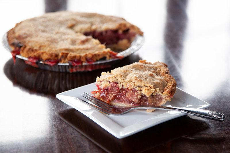 A full and a single slice of Raspberry Rhubarb Pie